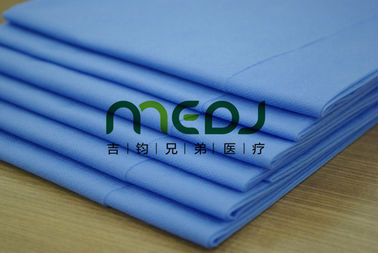 China Environmental Medical Paper Roll , Blue Customized Paper Bed Sheet Roll supplier